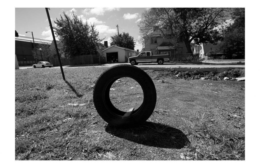 a lone tire in a vacant lot