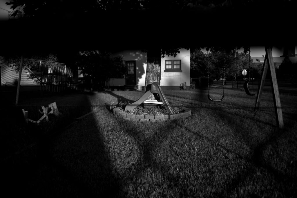 photo by Andrew Steiner, extreme noir shadows in yard